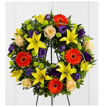 Exotic lilies,Aromatic Roses and Bright Gerbera Daisies Wreath Send to Manila Philippines