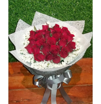 24 red roses with greenery
